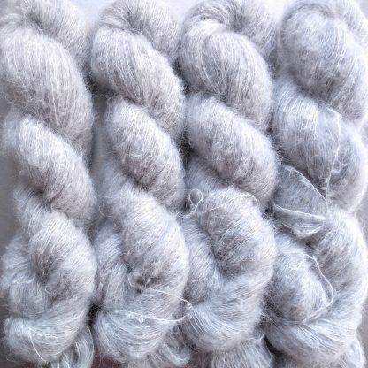 Silver - Pale silver-grey suri alpaca and silk luxury heavy laceweight yarn. Hand-dyed by Triskelion Yarn