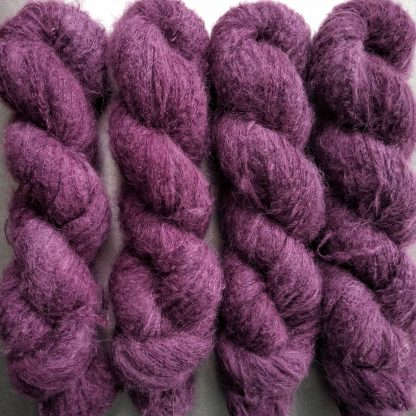 Tyrian Purple - Reddish mid to dark purple suri alpaca and silk luxury heavy laceweight yarn. Hand-dyed by Triskelion Yarn