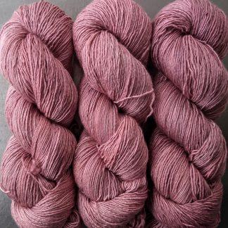 Ash Rose - Pale greyish pink Falklands Merino and silk blend yarn. Hand-dyed by Triskelion Yarn.