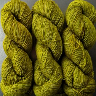 Frea - Light chartreuse green Falklands Merino and silk blend yarn. Hand-dyed by Triskelion Yarn.