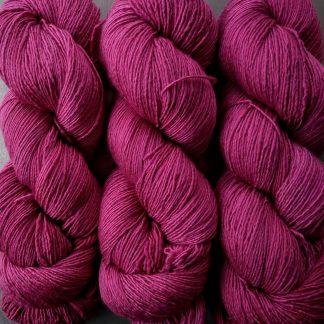 Rose - Vibrant deep rose Falklands Merino and silk blend yarn. Hand-dyed by Triskelion Yarn.