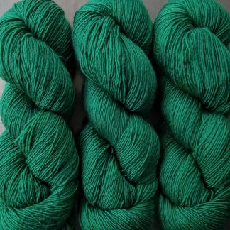 Weald - Deep forest green Falklands Merino and silk blend yarn. Hand-dyed by Triskelion Yarn.