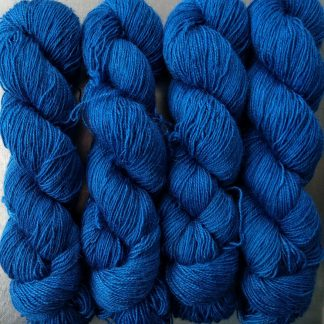 Royal Blue - Mid-tone royal blue Bluefaced Leicester (BFL) / Gotland / Wensleydale 4-ply (fingering) weight high-twist sock yarn. Hand-dyed by Triskelion Yarn