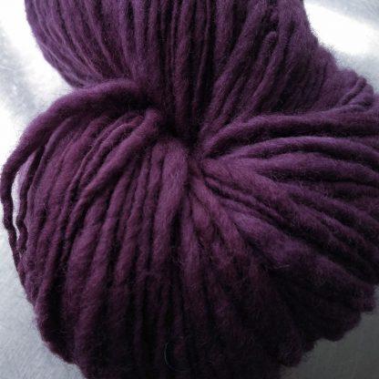 Blackcurrant - Dark reddish purple Corriedale thick and thin slub yarn. Hand-dyed by Triskelion Yarn