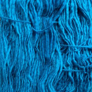 Cerulean - Mid-tone azure/cerulean blue Corriedale thick and thin slub yarn. Hand-dyed by Triskelion Yarn