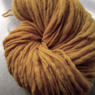 Lleu - Light golden yellow Corriedale thick and thin slub yarn. Hand-dyed by Triskelion Yarn