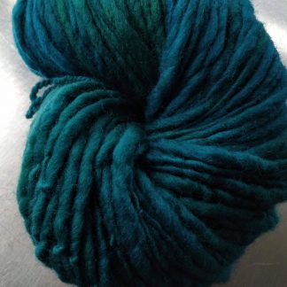 Ocean - Dark sea green/blue Corriedale thick and thin slub yarn. Hand-dyed by Triskelion Yarn
