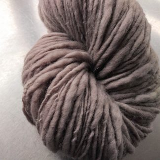 Pebble - Light warm grey/brown Corriedale thick and thin slub yarn. Hand-dyed by Triskelion Yarn