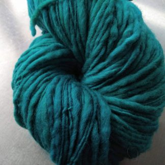 Corriedale thick and thin slub yarn. Hand-dyed by Triskelion Yarn