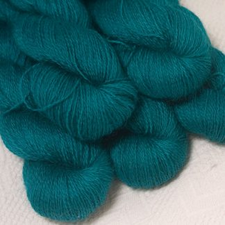 Fiachra - Mid-tone turquoise hand-dyed Wensleydale DK/ Double Knit yarn. Hand-dyed by Triskelion Yarn