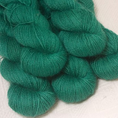Fionnuala - Light to mid-tone teal green hand-dyed Wensleydale DK/ Double Knit yarn. Hand-dyed by Triskelion Yarn