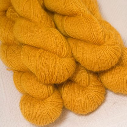 Lleu - Light golden yellow hand-dyed Wensleydale DK/ Double Knit yarn. Hand-dyed by Triskelion Yarn