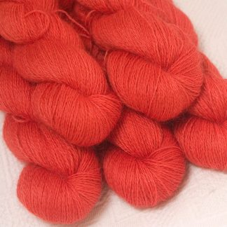 Reef - Mid-tone coral hand-dyed Wensleydale DK/ Double Knit yarn. Hand-dyed by Triskelion Yarn