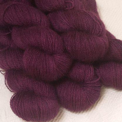 Tyrian Purple - Dark reddish purple hand-dyed Wensleydale DK/ Double Knit yarn. Hand-dyed by Triskelion Yarn