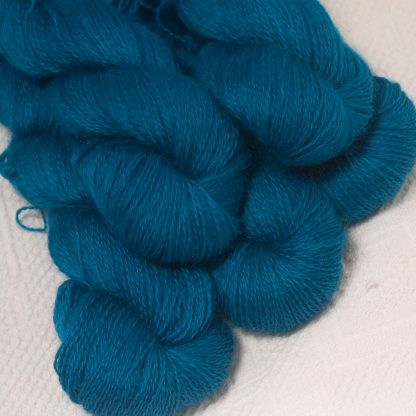 Wade - Mid-toned cerulean blue hand-dyed Wensleydale DK/ Double Knit yarn. Hand-dyed by Triskelion Yarn