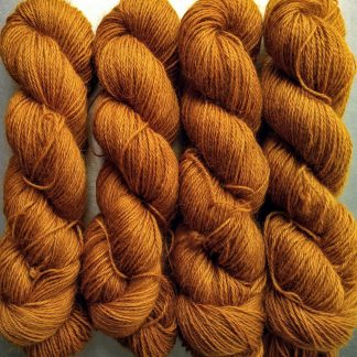 Amber - Dark ochre yellow hand-dyed Wensleydale DK/ Double Knit yarn. Hand-dyed by Triskelion Yarn
