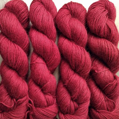 Boötes - Mid- to dark red hand-dyed Wensleydale DK/ Double Knit yarn. Hand-dyed by Triskelion Yarn