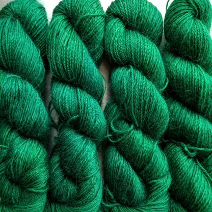 Emerald - Mid- to dark emerald hand-dyed Wensleydale DK/ Double Knit yarn. Hand-dyed by Triskelion Yarn