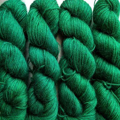 Emerald - Mid- to dark emerald hand-dyed Wensleydale DK/ Double Knit yarn. Hand-dyed by Triskelion Yarn