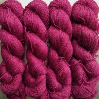 Idisi - Semi-solid deep rose hand-dyed Wensleydale DK/ Double Knit yarn. Hand-dyed by Triskelion Yarn