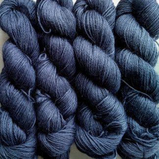 Storm - Mid- to dark bluish grey hand-dyed Wensleydale DK/ Double Knit yarn. Hand-dyed by Triskelion Yarn