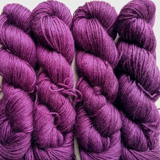 Tyrian Purple - Dark reddish purple hand-dyed Wensleydale DK/ Double Knit yarn. Hand-dyed by Triskelion Yarn