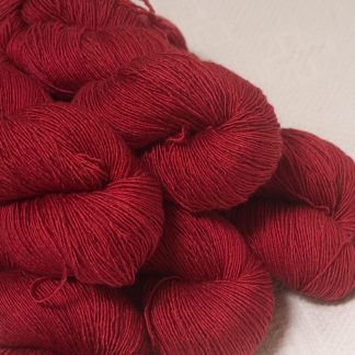 Boötes - Mid- to dark red Falklands Merino and silk blend yarn. Hand-dyed by Triskelion Yarn.