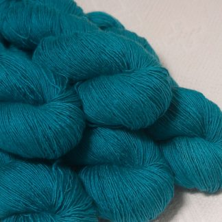 Fiachra - Mid-tone turquoise Falklands Merino and silk blend yarn. Hand-dyed by Triskelion Yarn.