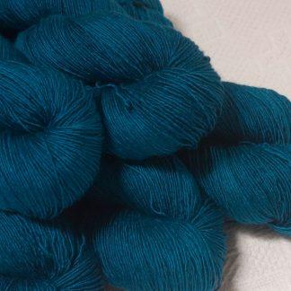 Llŷr - Deep petrol blue Falklands Merino and silk blend yarn. Hand-dyed by Triskelion Yarn.