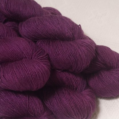 Tyrian Purple - Dark reddish purple Falklands Merino and silk blend yarn. Hand-dyed by Triskelion Yarn.