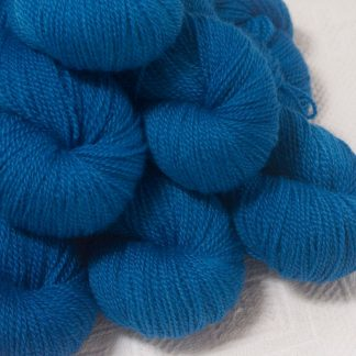 Ælfred - Mid-toned royal blue Bluefaced Leicester 4-ply / fingering weight yarn hand-dyed by Triskelion Yarns