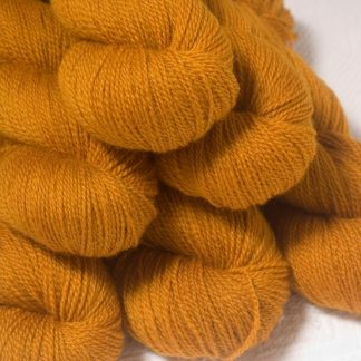 Amber - Dark ochre yellow Bluefaced Leicester 4-ply / fingering weight yarn hand-dyed by Triskelion Yarns