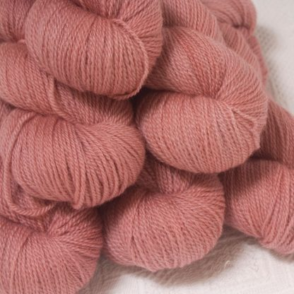 Ash Rose - Light greyish pink Bluefaced Leicester 4-ply / fingering weight yarn hand-dyed by Triskelion Yarns
