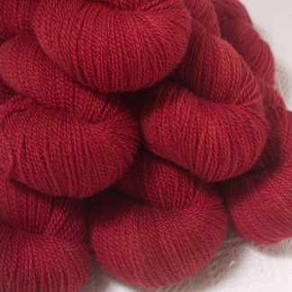 Boötes - Mid- to dark red Bluefaced Leicester 4-ply / fingering weight yarn hand-dyed by Triskelion Yarns