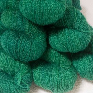Dinas Emrys - Mid- to dark emerald green Bluefaced Leicester 4-ply / fingering weight yarn hand-dyed by Triskelion Yarns