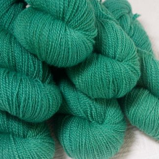 Fionnuala - Light to mid-tone teal green Bluefaced Leicester 4-ply / fingering weight yarn hand-dyed by Triskelion Yarns