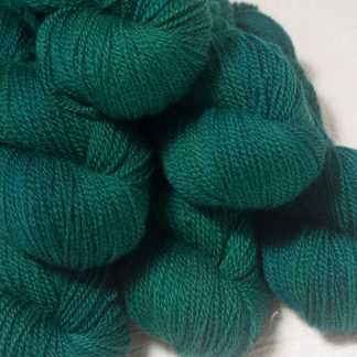 Grendel - Dark bluish-green Bluefaced Leicester 4-ply / fingering weight yarn hand-dyed by Triskelion Yarns