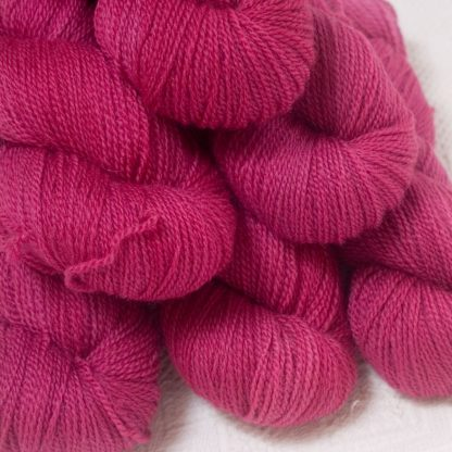 Idisi - Semi-solid deep rose Bluefaced Leicester 4-ply / fingering weight yarn hand-dyed by Triskelion Yarns