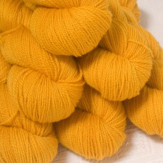 Lleu - Light golden yellow Bluefaced Leicester 4-ply / fingering weight yarn hand-dyed by Triskelion Yarns