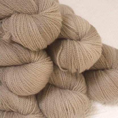Pebble - Pale greyish brown Bluefaced Leicester 4-ply / fingering weight yarn hand-dyed by Triskelion Yarns