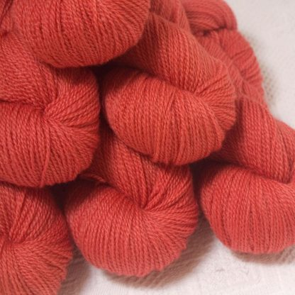 Reef - Mid-tone coral Bluefaced Leicester 4-ply / fingering weight yarn hand-dyed by Triskelion Yarns