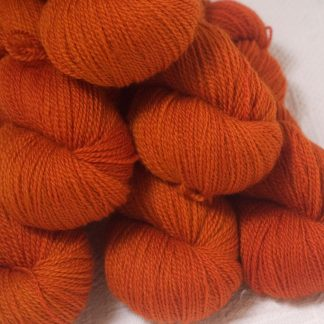 Sunburst - Bright mid- to dark orange Bluefaced Leicester 4-ply / fingering weight yarn hand-dyed by Triskelion Yarns