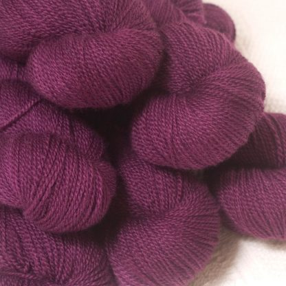 Tyrian Purple - Dark reddish purple Bluefaced Leicester 4-ply / fingering weight yarn hand-dyed by Triskelion Yarns