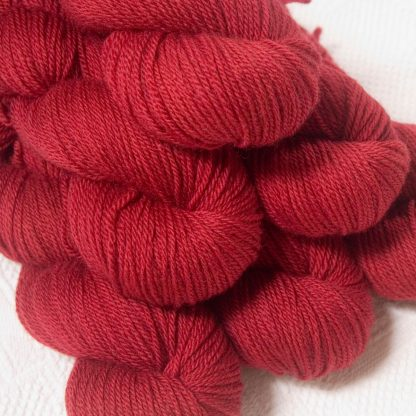 Boötes - Mid- to dark red Bluefaced Leicester DK (double knit) yarn hand-dyed by Triskelion Yarns