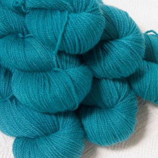 Fiachra - Mid-tone turquoise Bluefaced Leicester DK (double knit) yarn hand-dyed by Triskelion Yarns