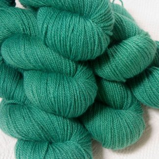 Fionnuala - Light to mid-tone teal green Bluefaced Leicester DK (double knit) yarn hand-dyed by Triskelion Yarns