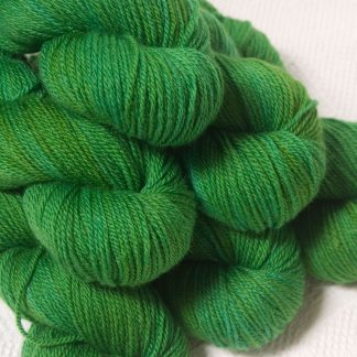 Gerda - Mid tone grassy green Bluefaced Leicester DK (double knit) yarn hand-dyed by Triskelion Yarns