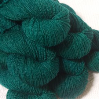 Grendel - Dark bluish-green Bluefaced Leicester DK (double knit) yarn hand-dyed by Triskelion Yarns