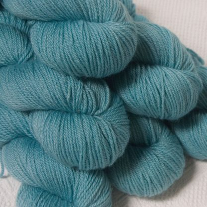 Horizon - Light sky blue Bluefaced Leicester DK (double knit) yarn hand-dyed by Triskelion Yarns