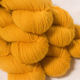 Lleu - Light golden yellow Bluefaced Leicester DK (double knit) yarn hand-dyed by Triskelion Yarns